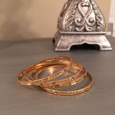 Gold Lion 24k Gold Bangle Bracelets Never used.  In box.  Gold lion bracelets. Gold Lion Jewelry Bracelets