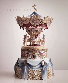 The creator, Özlem Arabici, takes a simple list of cake ingredients and creates ornate masterpieces worthy of a gallery. Unique Cakes, Creative Cakes, Gorgeous Cakes, Pretty Cakes, Amazing Wedding Cakes, Amazing Cakes, Fondant Cakes, Cupcake Cakes, Carousel Cake