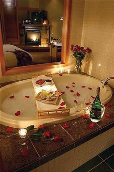 Set the mood with a stunning bath covered in rose petals and surrounded by candles. #Romantic #Sexy #Relationship #Love
