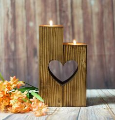 Please Read item details and shipping/policies Reclaimed Wood Candle Holder Set: - 2 connecting Holders with Heart cut-outs *Reclaimed wood may have nail holes (no Nails), cracks, and/or discolorations that make it look all the more interesting! Stained a warm chestnut. Approx Measurements: 6-8 in Height The length of each piece is 2, so a total length of 4 and width of 2 This is approximate, as each piece of wood may differ slightly. Accurate within .5 * Photo props not included...