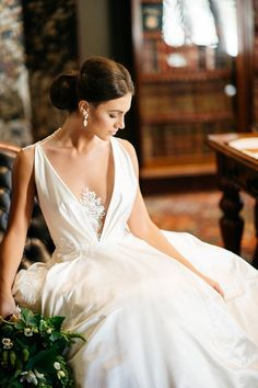 Elegant wedding dress with deep V and lace illusion neckline | Two People Photography