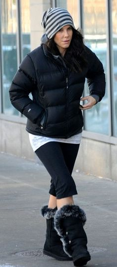 Who made Sandra Bullock's black down coat and boots?