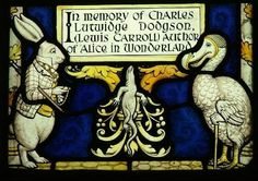 Stained glass window in Daresbury Church, Cheshire, England,depicting Lewis Carol's Alice in Wonderland scene