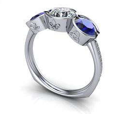 Customers design in 14kt white gold, European shank, sapphire and diamond half bezel set with a heather, fleur de lis, and Celtic knot. Diamonds down shank