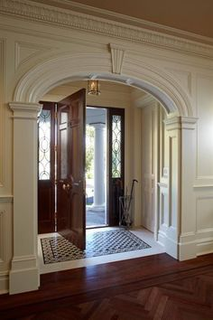 Beautiful moulding! Tiles in entrance.