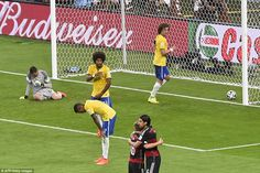 World Cup hosts face up to utter humiliation of 7-1 defeat at hands of Germany: Hopeless: Brazil's goalkeeper Julio Cesar (left) and the Brazilian defenders react after failing to stop Germany's striker Andre Schuerrle s...