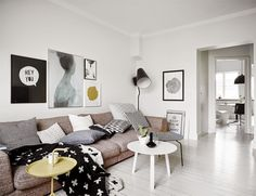 Yep, this is some pretty stylish apartment. From the living room which is an amazing mix of a...