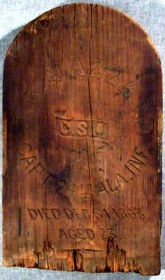 """Wooden grave marker of Captain John B. Hazard (the marker spells it """"Hazzard"""") of the 24th Alabama Infantry.  Captain Hazzard was wounded and captured at Missionary Ridge and was sent to the Union POW camp at Johnson's Island, Sandusky, Ohio.  He died there on December 31, 1863 at age 23.  He is buried in Grave 107 in the Johnson's Island Confederate Civil War Prison Cemetery, Sandusky, Ohio."""