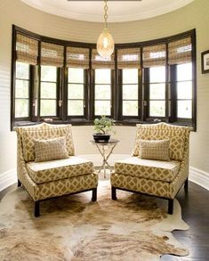 teresa: Brown Design - Imperial trellis fabric chairs, white and brown cowhide rug, chandelier, ...