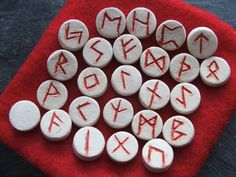 These mini ceramic pottery runes have been individually hand made and carved with the Elder Futhark rune symbols using a white earthenware clay. They were fired once to 1000C in my kiln before filling each rune symbol with a coloured glaze. The set was then fired again to 1120C. The result is a set of mini ceramic rune stones, with rich red symbols at a size that is ideal as a travelling set. https://www.etsy.com/uk/listing/171233427/handmade-ceramic-pottery-clay-runes-with