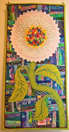 """Wallflower by Jeanne Treleaven, posted by Pam Holland.  Artist statement:  """"I was introduced to China Grove Myles and the Gees Bend Quilters in 2010 and was both inspired and overwhelmed by their quilts. I especially wanted to reproduce the Pine Burr Pattern and have incorporated it these whimsical pieces."""""""