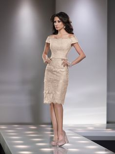 Lace over chiffon and satin knee-length sheath with short sleeves, off-the-shoulder neckline with eyelash rim, satin belt at natural waist, slim four-tiered skirt with scalloped hemline and center back slit, suitable for the mother of the bride or the mother of the groom. As shown in Black: Embellish by David Tutera ring style Hadley, necklace [...]