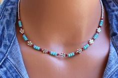 Beaded Turquoise Necklace, Silver Flower Bead Necklace, Boho Chic Beaded Necklace, Womens Necklace, Gift For Her, Bohemian style Necklace Playful and fun with a boho chic style, this new necklace by Tam Davis is full of casual charm. Genuine turquoise and coral are mixed with silver