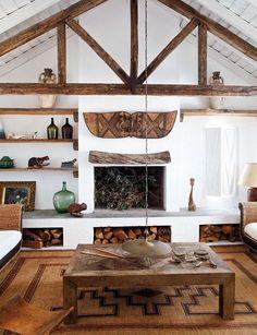 raised fireplace with log storage underneath. Malian reed matt. Senegalese chair. shutters