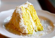 A Pina Colada Cake to make you feel like you're on a tropical holiday. Perfect combination of pineapple and coconut cake with cream cheese coconut frosting.