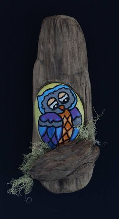 owl painted rock with wood