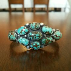Check out this item in my Etsy shop https://www.etsy.com/listing/268293906/native-american-turquoise-and-silver