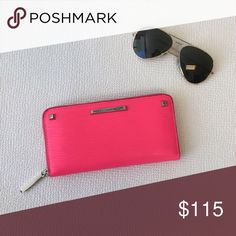 Pink Rebecca Minkoff Wallet Make a statement with this cute wallet! Rebecca Minkoff wave textured leather continental wallet with stud detail. Features two interior slip pockets, an interior zip pocket and eight card slots. Reasonable offers considered. Rebecca Minkoff Bags Wallets