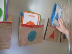 Brown Bags and Shapes. Audrey knows all her shapes & colours so I wld adapt this to suit our focus!