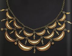 Necklace with Crescents and Fish South Sulawesi, Bug, 19th century Gold, L 40 cm. Similar chain necklaces with multiple elements were also manufactured in West Sumatra and Aceh, where the last royal dynasty was of Buginese heritage.