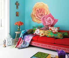 Big roses on turquoise wall