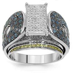 This exquisite diamond engagement ring is crafted in lustrous 14K White Gold. This uniquely designed ring is adorned with blue and white round cut diamonds. The rectangle center piece is highlighted with numerous small princess cut diamonds. Express your individuality with this large diamond ring which guarantees an onlookers attention. $3,541.00