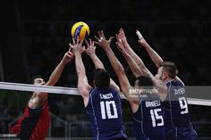 Filippo Lanza, Emanuele Birarelli and Ivan Zaytsev of Italy in defence against the united States during the Men's Volleyball Semifinal match on Day 14 of the Rio 2016 Olympic Games at the Maracanazinho on August 19, 2016 in Rio de Janeiro, Brazil.