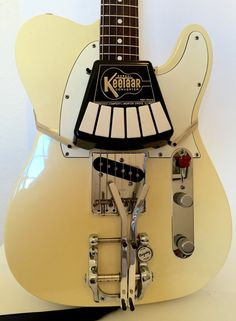 Vintage NOS Guitar to Keytar Converter lets you play guitar like a piano WTF