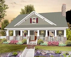 Architectural Designs Country Craftsman With Drive-Under Garage  2 beds + bunk and rec area on the upper floor 2 car drive under garage Just under 1,900 sq. ft.