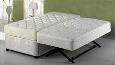 twin daybed - trundle makes it a king. would need to have a slipcover made for the 'box spring'/trundle portion.1099.