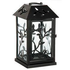 Vine silhouettes give this decorative black metal lantern botanical appeal. Use it to cast pretty shadows - and warm candle glows - anywhere in your décor.  Black metal candle lantern Metal vine design on glass Vine cutouts in top D-ring handle Black snap latch 5.25 x 5.25 inches 9 inches tall (not including ring)