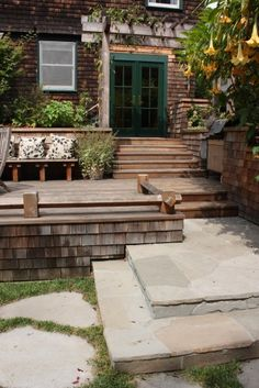 traditional patio by Goodman Landscape Design - nice wide steps, shingled sides, good connection to stone steps and then patio. No to the railings.