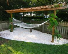 Our Tropical Oasis On those summer night there is nothing better than relaxing in the hammock. It is our tropical oasis. Find out how easy it is to have your own tropical oasis with this DIY backyard hammock area tutorial. Backyard Hammock, Backyard Playground, Small Backyard Landscaping, Backyard Pergola, Backyard For Kids, Landscaping Ideas, Hammock Ideas, Pergola Kits, Oasis Backyard