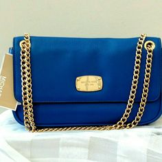 """NEW Michael Kors Jet Set Chain Small Flap bag Set Shoulder Flap bag in electric blue. Ultra soft pebble leather. Michael Kors logo plaque on flap. Back slip pocket. Chain Strap. Top flap magnetic snap closure. Signature lining. Interior zip pocket, six credit card slots; one slip pocket. Approximate measurements: (L) 10.5 x (H) 5.5 x (W) 2 inches Chain strap with double 7.5"""" or single 16"""" drop. Michael Kors Bags Shoulder Bags"""