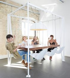 Playtime Table!Duffy London, Their latest design, the Swing Table, puts a little extra fun into dinner time or collaborative meetings by using an unorthodox structure with suspended chairs that swing and sway. Chairs that can be adjusted to the seated person's liking, making the design as functional as it is playful. Not to mention, it makes vacuuming a breeze.