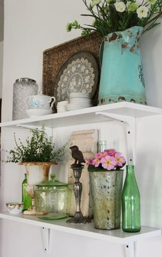 Simple shelves with a mix of vintage wares is a great way to bring an easy and eclectic design to the kitchen!