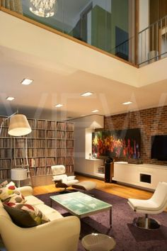 PRIVATE HOUSE AMBIENCE CONTRACTS LONDON 2010 OPEN PLAN LIVING SPACE WITH SOFA AND COFFEE TABLE
