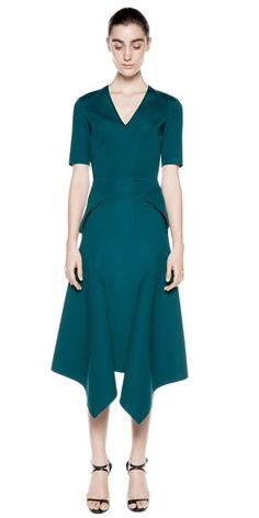 V neck front, angular peplum hem fitted at torso, with zip closure at centre back.