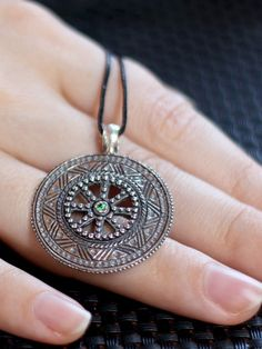 Silver pendant, made from photographs of ancient Hutsul jewelry, finish in the middle – it is a sign of Perun, the rotation symbol of the sun, life – such signs carved on the most expensive items in need of protection. 145$