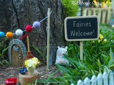 Fairy Garden in a tree stump : www.theMagicOnions.com I want to go to this moms house and play!