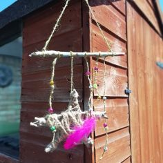 Using sticks and beads we made a pretty hanging for the garden. Picture Gifts, Rock Design, Shopping Day, Party Packs, Craft Videos, Plant Hanger, My Best Friend, Arrow Necklace, I Am Awesome