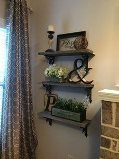 We made theses shelves for less than $20!!! Pallet wood (free) and metal shelf…