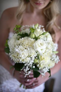 Classic white flower wedding bouquet - lisianthus, hydrangeas and baby's breath {Impressions Photography}