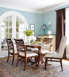 Love the sky blue walls with the brown drapes and dark wood furniture