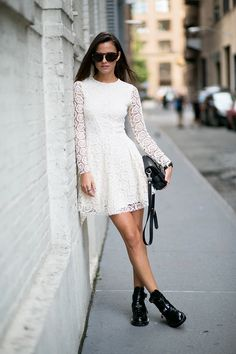 Zina Charkoplia is wearing a whtie lace dress from H&M, bag from Proenza Schouler, boots from Balenciagam and sunglasses from Opening Ceremony