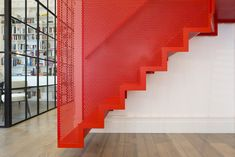 A staircase that hangs from the ceiling to create a striking architectural form   Inspirationist