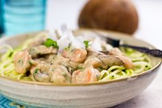 Creamy Shrimp On Zucchini Pasta 600g cauliflower, roughly chopped ¾ cup water 1 cup pure coconut water ½ tsp Himalayan or fine sea salt ½ tsp freshly cracked black pepper 225g mushrooms, sliced 1 small onion, very finely chopped 300g cooked shrimp (size 71-90) ½ cup coconut cream ¼ cup fresh cilantro, chopped the juice of 1 lime ¼ tsp garam masala 2 large zucchinis, peel on, stringed (or julienned)