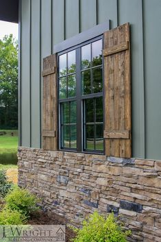 Exterior Window Details Custom-built lakehouse features rich nature-inspired tones and natural elements including natural stained shutters, stacked stone and dark brown-trimmed windows. House Paint Exterior, Exterior House Colors, Exterior Design, Dark Siding House, Stone On House Exterior, Rock Siding, Exterior Siding, Exterior Remodel, Ideas Cabaña