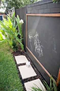 Great chalkboard set-up for concrete wall, toddler playground or side area. #playhousesforoutside