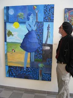Dennis Tawes and his painting.